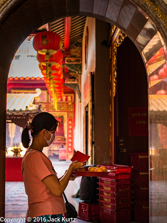 "03 FEBRUARY 2016 - BANGKOK, THAILAND:  People make merit at Wat Mangon Kamlawat, the largest Mahayana (Chinese) Buddhist temple in Bangkok, before the celebration of Chinese New Year. Thailand has the largest overseas Chinese population in the world; about 14 percent of Thais are of Chinese ancestry and some Chinese holidays, especially Chinese New Year, are widely celebrated in Thailand. Chinese New Year, also called Lunar New Year or Tet (in Vietnamese communities) starts Monday February 8. The coming year will be the ""Year of the Monkey.""                       PHOTO BY JACK KURTZ"