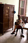 Two children sit together in a school for mentally disabled children in Havana, Cuba.