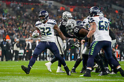 Seattle Seahawks Running Back Chris Carson (32) runs in for a touchdown, but its brought back by a holding foul during the International Series match between Oakland Raiders and Seattle Seahawks at Wembley Stadium, London, England on 14 October 2018.