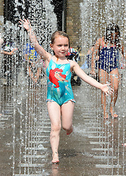 © Licensed to London News Pictures. 19/08/2012. London, UK Charlotte Kendrick aged 4 enjoys the water. Children play in the fountains at Granary Square in North London today. 1080 dancing jets of water make up the new fountain in its centre. Today is expected to be the hottest day of the year with temperature peaking at over 32 degrees celsius. Photo credit : Stephen Simpson/LNP