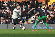 Fulham Striker, Ross McCormack (44) taking on Bristol City defender, Aden Flint (4) during the Sky Bet Championship match between Fulham and Bristol City at Craven Cottage, London, England on 12 March 2016. Photo by Matthew Redman.