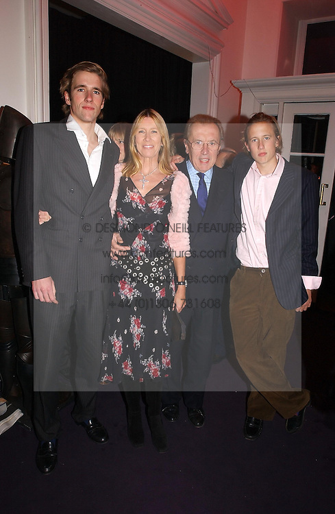 Left to right, MR WILFRED FROST, SIR DAVID & LADY CARINA FROST and MR GEORGE FROST at a party hosted by jeweller Theo Fennell and Dominique Heriard Dubreuil of Remy Martin fine Champagne Cognac entitles 'Hot Ice' held at 35 Belgrave Square, London, W1 on 26th October 2004.<br /><br />NON EXCLUSIVE - WORLD RIGHTS