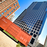 Prairie Logic boxcar on green roof at downtown Kansas City's Power and Light District, with the skyscraper 1201 Walnut towering behind.
