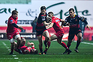 Dragons' Sam Beard breaks the tackle of Scarlets' Steffan Hughes<br /> <br /> Photographer Craig Thomas/Replay Images<br /> <br /> Guinness PRO14 Round 13 - Scarlets v Dragons - Friday 5th January 2018 - Parc Y Scarlets - Llanelli<br /> <br /> World Copyright &copy; Replay Images . All rights reserved. info@replayimages.co.uk - http://replayimages.co.uk