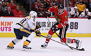 April 13, 2017 - Chicago, IL, USA - The Nashville Predators' Viktor Arvidsson (38) blocks the shot attempt of the Chicago Blackhawks' Artem Anisimov (15) in the first period of Game 1 in the first round of the playoffs at the United Center in Chicago on Thursday, April 13, 2017. (Credit Image: © Chris Sweda/TNS via ZUMA Wire)