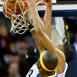 Nov 26, 2013; New Orleans, LA, USA; New Orleans Pelicans power forward Anthony Davis (23) dunks over Golden State Warriors center Jermaine O'Neal (7) during the second half of a game at New Orleans Arena. The Warriors defeated the Pelicans 102-101. Mandatory Credit: Derick E. Hingle-USA TODAY Sports