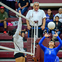Navajo Pine Warrior Alexis Hood (9), right, performs a set for a spike to the Ramah Mustangs at Ramah High School Thursday.