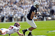 Sept 19, 2009; State College, PA, USA; Temple cornerback Kevin Kroboth (37) misses a tackle on Penn State wide receiver Derek Moye (6) during the first half at Beaver Stadium.  Mandatory Credit: Jason Miller-US PRESSWIRE