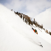 Guide Jacob Stinson skiing a back country line in the Tetons.