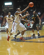 """Ole Miss guard Dundrecous Nelson (5)  passes at the C.M. """"Tad"""" Smith Coliseum in Oxford, Miss. on Sunday, January 2, 2011. (AP Photo/Oxford Eagle, Bruce Newman)"""
