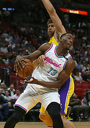 March 1, 2018 - Miami, FL, USA - The Miami Heat's Bam Adebayo grabs a rebound against the Los Angeles Lakers' Brook Lopez during the first quarter at the AmericanAirlines Arena in Miami on Thursday, March 1, 2018. The Lakers won, 131-113. (Credit Image: © David Santiago/TNS via ZUMA Wire)