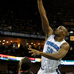 January 16, 2012; New Orleans, LA, USA; New Orleans Hornets center Emeka Okafor (50) shoots over Portland Trail Blazers power forward LaMarcus Aldridge (12) during the second quarter of a game at the New Orleans Arena.   Mandatory Credit: Derick E. Hingle-US PRESSWIRE