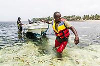 Marine rangers undertaking a boat patrol, Mombasa Marine Protected Area, Kenya