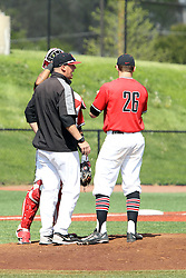 17 April 2016:  pitching coach Michael Kellar and catcher MJean Ramirez make a trip to the mound to speak with pitcher David Meade during an NCAA Division I Baseball game between the Southern Illinois Salukis and the Illinois State Redbirds in Duffy Bass Field, Normal IL