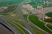 Nederland, Friesland, gemeente Wonseradeel, 28-04-2010; verkeersknoopppunt Zurich aan het eind van de Afsluitdijk, met windmolens in de Gooijumer- en Zuricherpolder.Intersection and wind mills.luchtfoto (toeslag), aerial photo (additional fee required).foto/photo Siebe Swart.Makkumerwaard