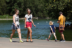 © Licensed to London News Pictures. 22/07/2014. London, UK. People walking and enjoying the sunshine in St James's Park in central London this lunchtime. Photo credit : Vickie Flores/LNP
