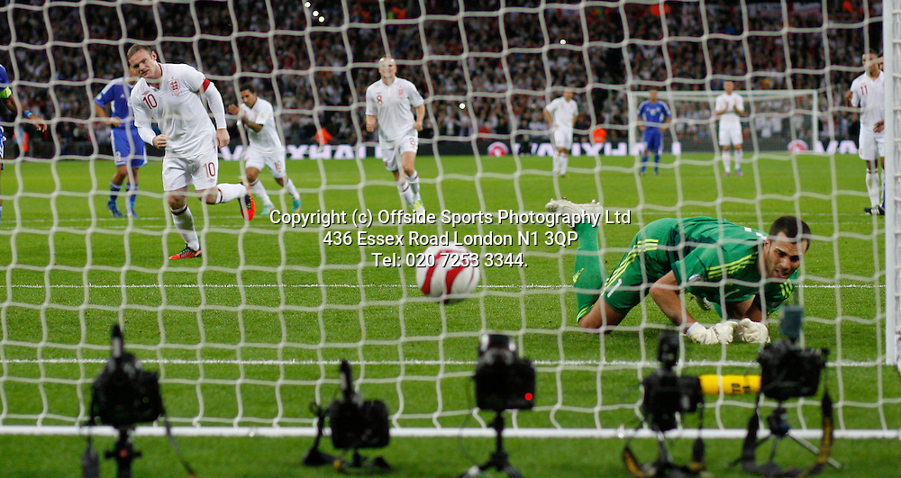 12 October 2012 Football. England v San Marino.<br /> Wayne Rooney beats goalkeeper Simoncini to score from the penalty spot.<br /> Photo: Mark Leech.
