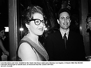 Lynn Hirschberg and  Jerry  Seinfeld at the  Vanity Fair Oscar  night party, Mortons, Los Angeles. 23 March 1988. Film 98150f3<br />Copyright Photograph by Dafydd Jones<br />66 Stockwell Park Rd. London SW9 0DA<br />Tel. 0171 733 0108