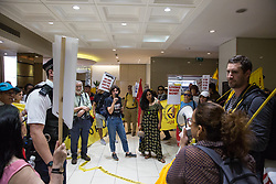 London, UK. 1 June, 2019. Members of the United Voices of the World (UVW) and Independent Workers of Great Britain (IWGB) grassroots trade unions protest inside the DoubleTree Hilton Hotel in solidarity with Dalia Quinonez Guerrero (r), a former cleaner from whom wages were withheld. The protest was previously arranged to have taken place outside Chanel but arrangements were changed after the global fashion chain agreed to pay its cleaners the London Living Wage at its stores.