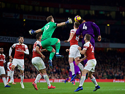 LONDON, ENGLAND - Saturday, November 3, 2018: Liverpool's Virgil van Dijk (#4) challenges for a header with Arsenal's Rob Holding during the FA Premier League match between Arsenal FC and Liverpool FC at Emirates Stadium. (Pic by David Rawcliffe/Propaganda)