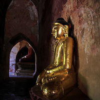 Worshipping golden Buddha statues, Sulamani temple, Bagan, Myanmar, 2015
