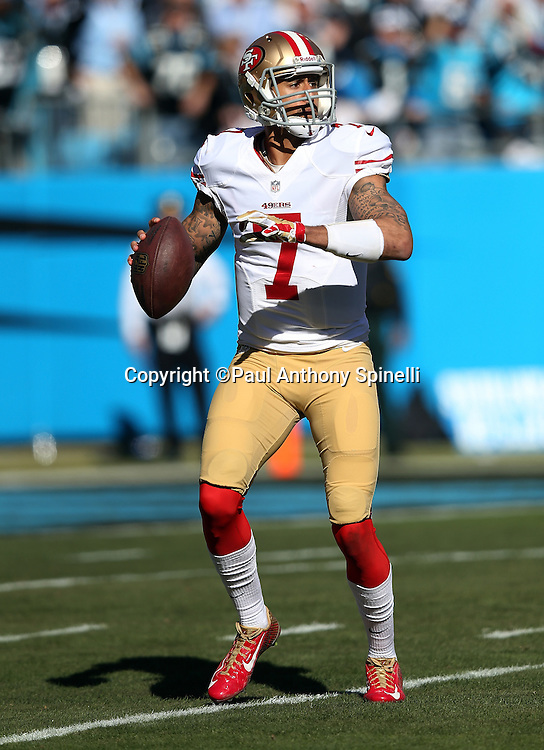 San Francisco 49ers quarterback Colin Kaepernick (7) looks to pass on a first quarter play during the NFC Divisional Playoff NFL football game against the Carolina Panthers on Sunday, Jan. 12, 2014 in Charlotte, N.C. The 49ers won the game 23-10. ©Paul Anthony Spinelli