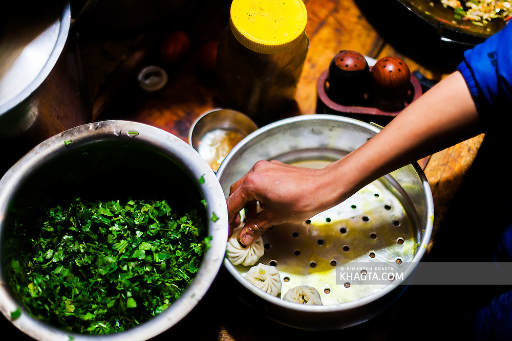 Momo being prepared at a Spiti home. Momos stuffed with chilly sauce is quite a frequent meal in Spiti. When its stuffed with Yak meat, it becomes a delicacy.