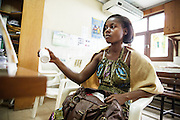 Marielle Gnabrayou Digbeto, 28, holds a pill bottle with her medication during a counseling session at the Koumassi general hospital in Abidjan Cote d'Ivoire on Friday July 19, 2013. Marielle is pregnant with her first child and HIV positive.