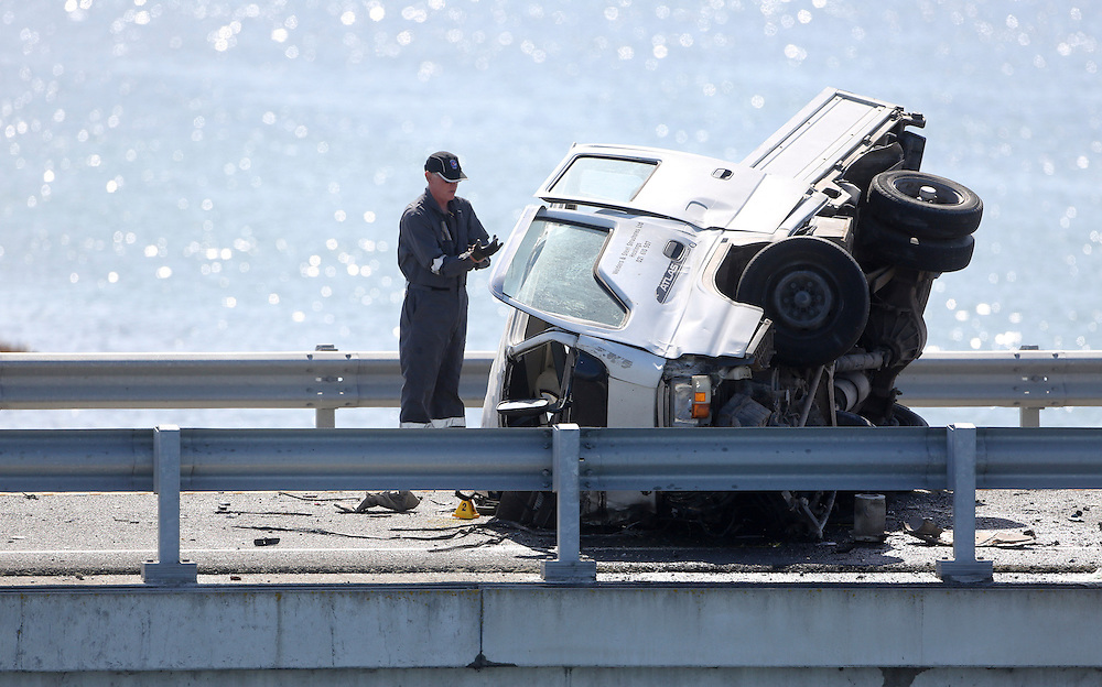 Police examine the wreckage of a light truck at a fatal accident on the Expressway near the airport, Napier, New Zealand, Sunday, November 25, 2012. Credit: SNPA / John Cowpland