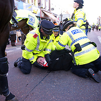 A member of the English Defence League (EDL) is arrested during a protest in Preston, England on November 27, 2010. Approximately 1,000 protestors assembled for the rally and numerous arrests took place.  A counter-protest demonstration by Unite Against Facism (UAF) took place nearby.