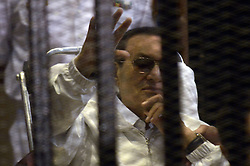 59512455 - The former Egyptian President Hosni Mubarak (C) and his two sons Gamal Mubarak (1st L) and Alaa Mubarak (2nd R) attend the trial in Cairo, Egypt, April 13, 2013. Former Egyptian President Hosni Mubarak arrived in the Police Academy in Cairo s outskirts for his retrial Saturday morning, state TV reported, 13 April 2013. Photo by: imago / i-Images. .UK ONLY