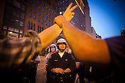Riot police lines up on the street as Anti Nato protesters march downtown in Chicago, IL,  May 19th 2012.