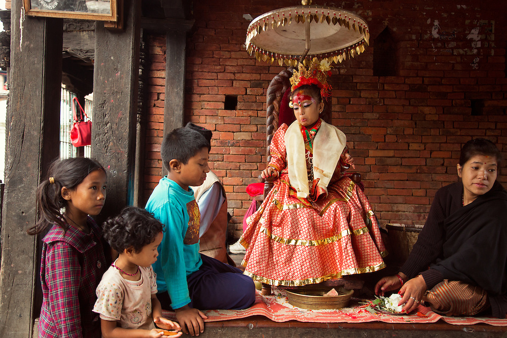 Smriti Bajrcharya, 7, the Kumari of Bungmati, sits on her throne during one of the many auspicious days when she is worshiped. However, four days after the devastating earthquake in April, she lost one of her upper teeth while playing with friends, resulting in her immediate termination as kumari. It's believed that the spirit of the goddess, the shakti, that enters the girl's body when she becomes a kumari, will leave her if she loses any blood. While some in the community fear her tooth loss means bad luck, her family believes the earthquake forced the goddess to leave her body.