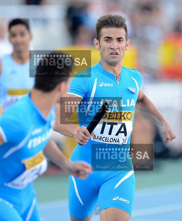 BARCELONA, Spain: Saturday 14 July 2012, Vito Incantalupo of Italy hands over the baton at the first change over in the mens 4x400m during day 5 of the IAAF World Junior Championships at the Estadi Olimpic de Montjuic..Photo by Roger Sedres/ImageSA
