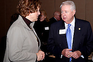 Susan Phillips of Congressman Steve Austria's office (left) talks with Bob Doyle of Dinsmore & Shohl LLP during the Dayton Area Chamber of Commerce Government Affairs Breakfast at the Crowne Plaza Hotel in downtown Dayton, Wednesday, November 30, 2011.