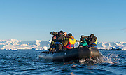 Nature photographers with long lenses at Hydruga Rocks, the palmer Archipelago, Antarctica.