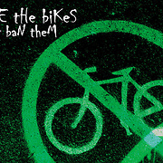 "Bicycling Postcard - Ride the Bikes - Don't Ban Them. Suitable for use on a 4.25"" x 6"" printed postcard."