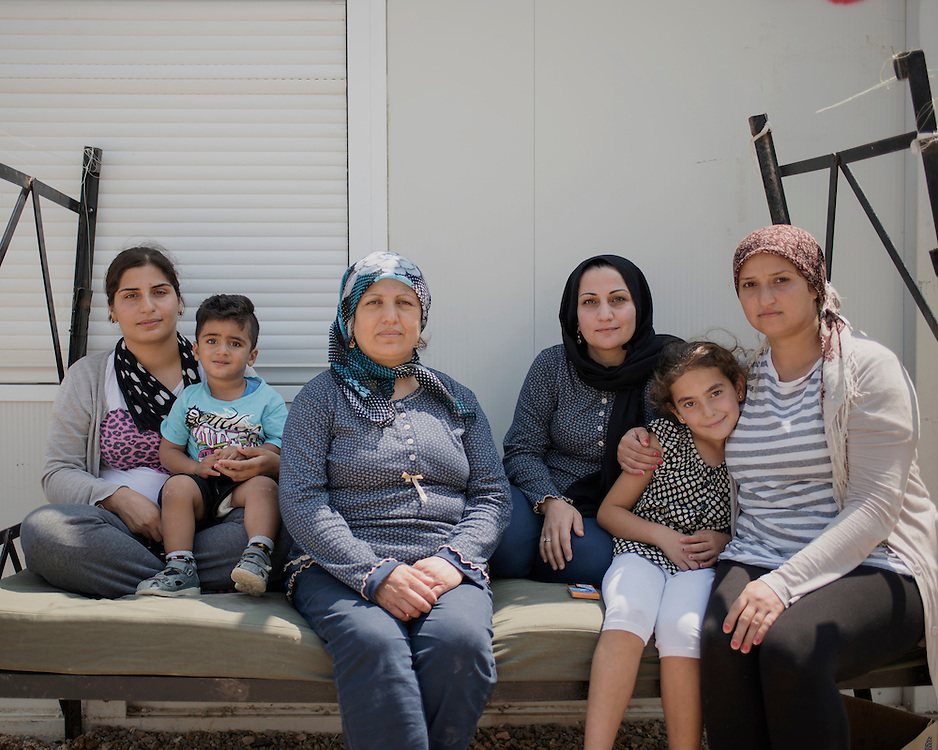 Shirin, Levent, Jamila, Wafa, Aya, Rania (L-R) refugees from Aleppo and Al Hasakah outside their hut in the First Reception Centre (Hot-Spot) of Leros, Greece. <br />