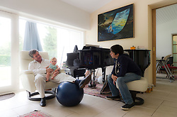 """Dr. Stephane Huberty, with his daughter Isalyne, and his son Arnaud, at their home in Rixensart, Belgium, on August 7, 2010. Dr. Huberty suffers from myasthenia gravis, a rare neurological condition. It is one of more than 5,000 """"orphan"""" diseases, so called because there are so few sufferers that most pharmaceutical companies are reluctant to invest in cures. The 48-year-old Belgian doctor, who has had the disease for 14 years, has been taking medication he and others developed, but he can't find investors to pay for a clinical trial. Pharmaceutical companies and other doctors say his product is unproven. So Dr. Huberty is taking a leaf out of 19th- century science and using himself as a guinea pig, and the results have been very positive. (Photo © Jock Fistick)"""