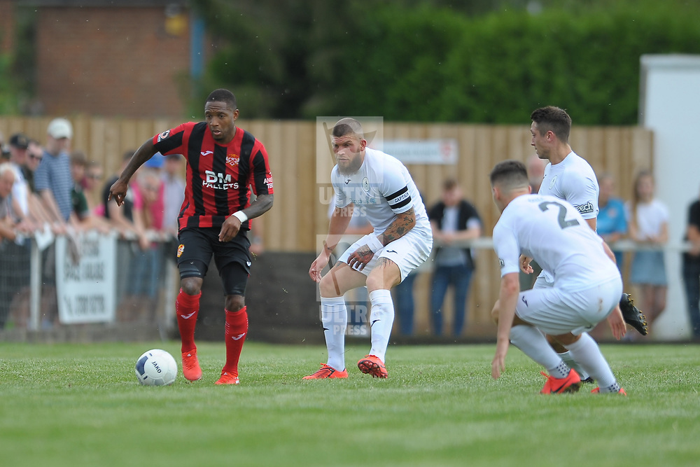 TELFORD COPYRIGHT MIKE SHERIDAN Shane Sutton, Adam Walker and Ross White keep an eye on Kettering's Joel Carta during the National League North fixture between Kettering Town and AFC Telford United at Latimer Park on Saturday, August 3, 2019<br />