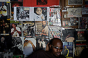 Rap Kreyol artist Jeff Mafia hangs out at Koze Kreyol, a recording studio in Port-au-Prince, Haiti, in front of a wall papered with magazine clippings featuring primarily American and Haitian rap and hip-hop artists on July 18, 2008. Koze Kreyol owner Emmanuel Cajuste compares rap kreyol to American hip-hop 20 years ago, in that it's more focused on politics and social issues than on bling, money and sex.