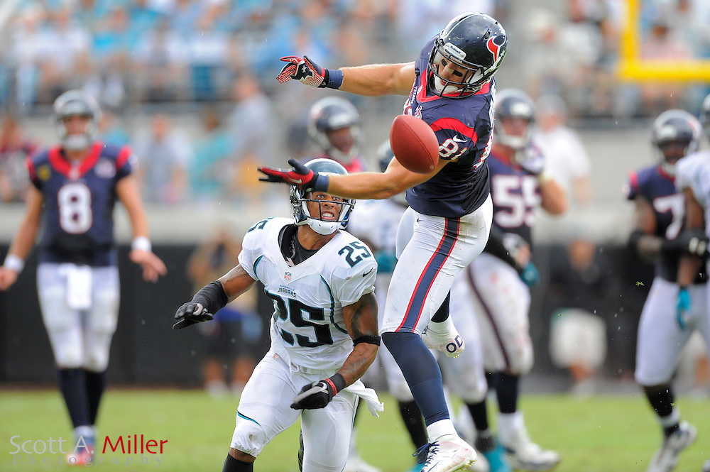 Houston Texans tight end Owen Daniels (81) goes airborne for a ball as he is defended by Jacksonville Jaguars strong safety Dwight Lowery (25) during their game at EverBank Field on September 16, 2012 in Jacksonville, Florida. ..©2012 Scott A. Miller..