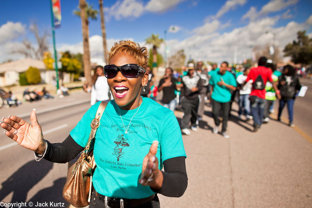 16 JANUARY 2012 - MESA, AZ: A woman from Mt Calvary Baptist Church, in Mesa, AZ, sings during the parade on Martin Luther King Day in Mesa, AZ, Monday, Jan. 16. Hundreds of people participated in the parade which marched through downtown Mesa.    PHOTO BY JACK KURTZ