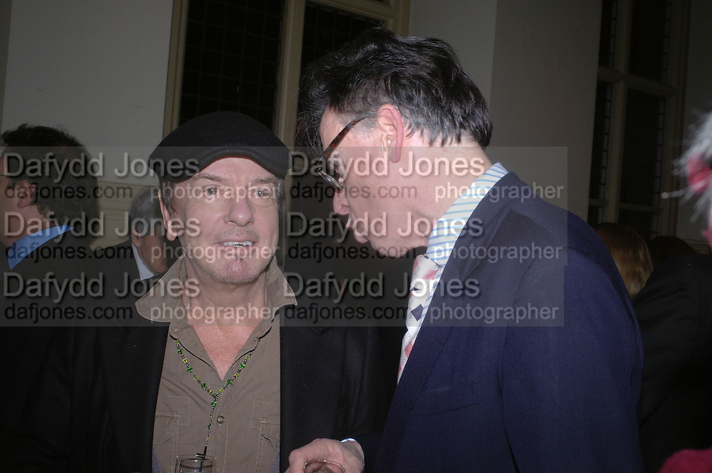 Nicky Haslam and Andrew Barrow. Annabel Freyberg and Andrew Barrow drinks party. The Royal Geographical Society. 5 January 2006. ONE TIME USE ONLY - DO NOT ARCHIVE  © Copyright Photograph by Dafydd Jones 66 Stockwell Park Rd. London SW9 0DA Tel 020 7733 0108 www.dafjones.com