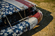 One of three cars driven by a local business owner sits idle before the demolition derby at the Summitt County Fairgrounds, Thursday, July 26, 2016 in Tallmadge, Ohio.