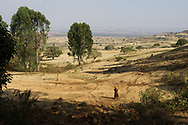 A woman walks to collect water - Muksan village, Ethiopia - shot for WaterAid
