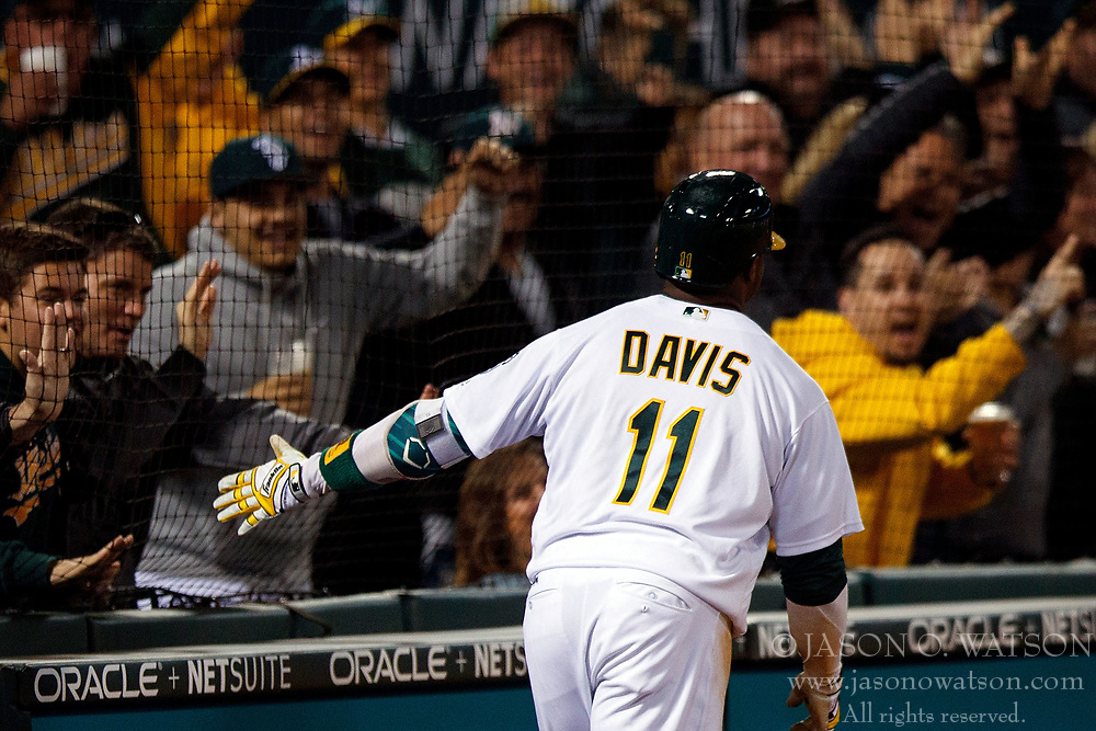 OAKLAND, CA - APRIL 04:  Rajai Davis #11 of the Oakland Athletics celebrates with fans after hitting a two run triple and scoring on a throwing error by Danny Espinosa (not pictured) of the Los Angeles Angels of Anaheim during the seventh inning at the Oakland Coliseum on April 4, 2017 in Oakland, California. The Los Angeles Angels of Anaheim defeated the Oakland Athletics 7-6. (Photo by Jason O. Watson/Getty Images) *** Local Caption *** Rajai Davis
