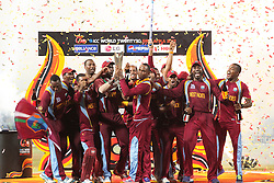 © Licensed to London News Pictures. 07/10/2012. The West Indian team celebrate during the trophy presentation during the World T20 Cricket Mens Final match between Sri Lanka Vs West Indies at the R Premadasa International Cricket Stadium, Colombo. Photo credit : Asanka Brendon Ratnayake/LNP