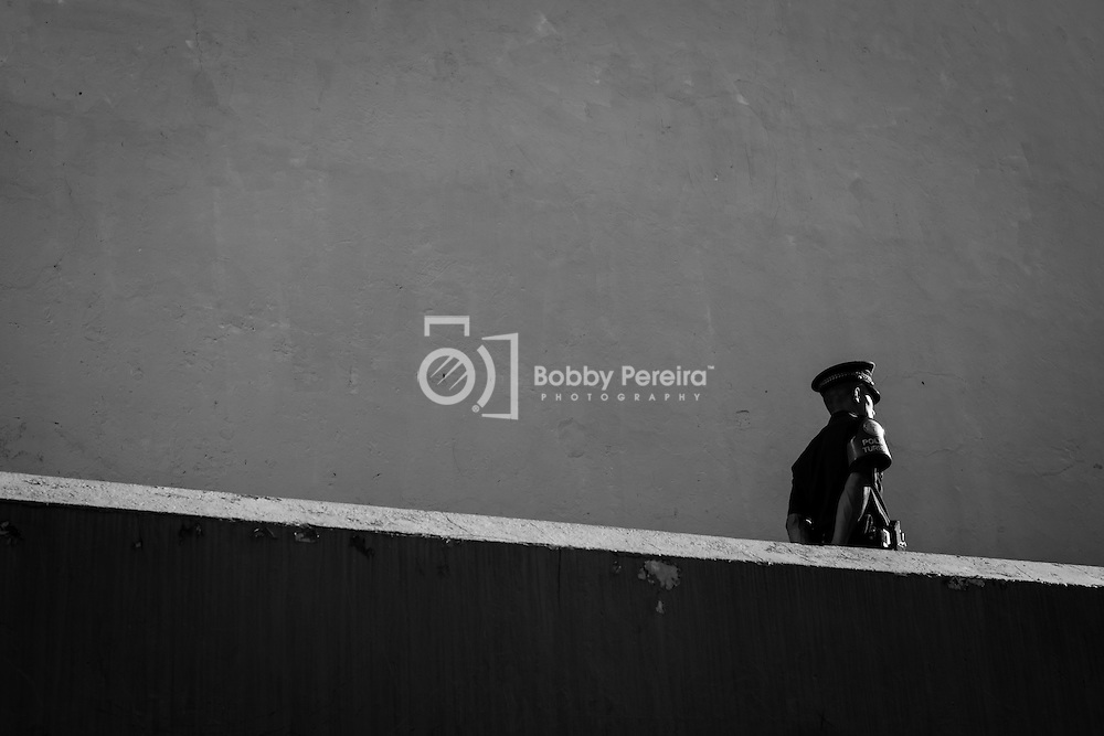 A Tourism Policeman makes his rounds on foot next to a church in Panama's Casco Viejo neighborhood