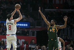 January 16, 2019 - Los Angeles, California, United States of America - Danilo Gallinari #8 of the Los Angeles Clippers takes a shot over Derrick Favors #15 of the Utah Jazz during their NBA game  on Wednesday January 16, 2019 at the Staples Center in Los Angeles, California. Clippers lose to Jazz, 129-109. JAVIER ROJAS/PI (Credit Image: © Prensa Internacional via ZUMA Wire)